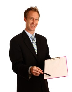13237-a-young-businessman-holding-a-clipboard-and-pen-or