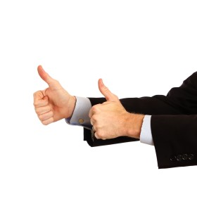 13241-a-young-businessman-making-a-thumbs-up-gesture-or